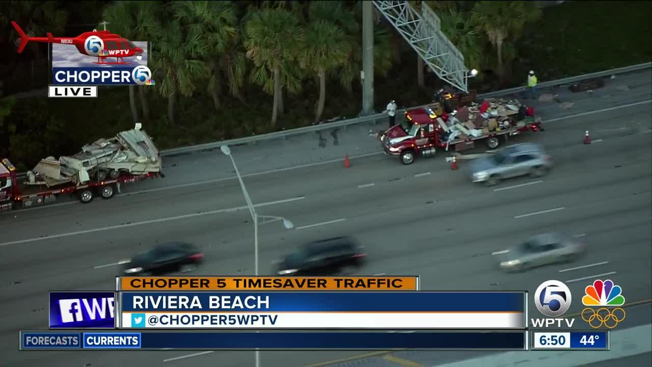 Crews clear debris off I-95 after car with trailer crashes
