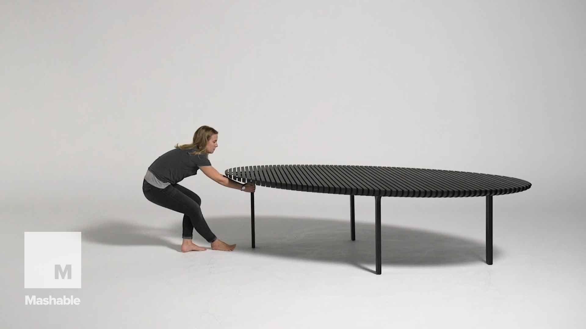 Someone designed an accordion-like table that unfolds to double its length