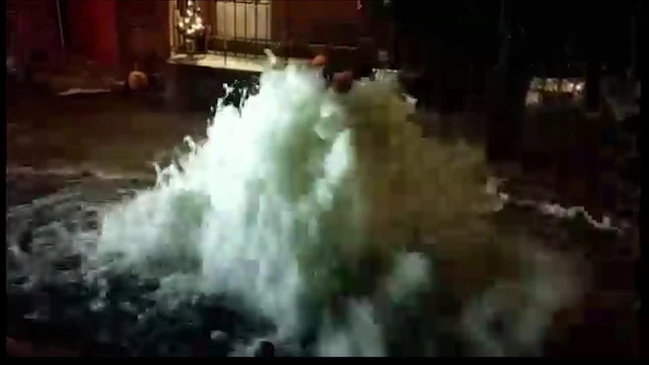 Water main break creates geyser and icy conditions in Lawrenceville