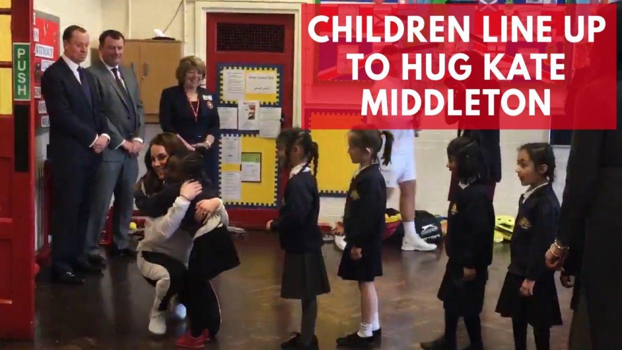 Children line up to hug Kate Middleton