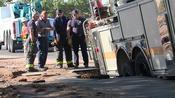 Fire Truck Gets Stuck in Sinkhole After Water Main Break in Denver
