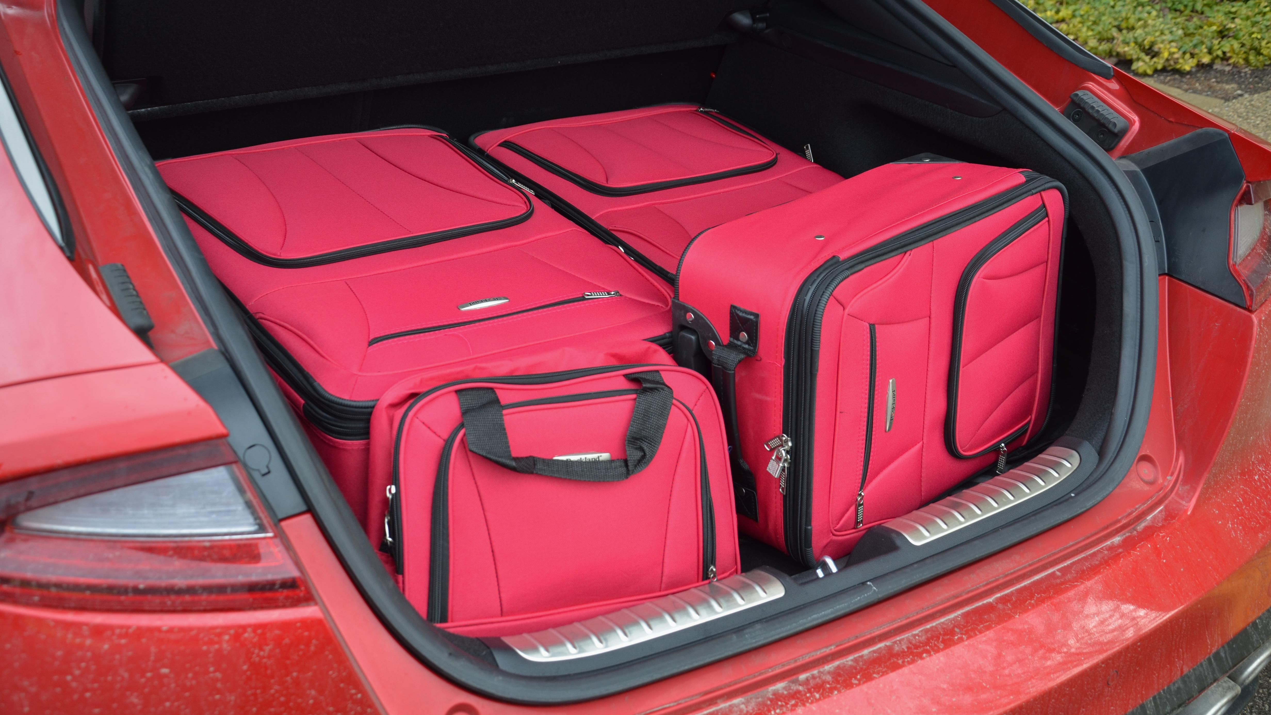 2018 Kia Stinger GT Long-Term Review | We stuff a four-piece set of luggage in the hatch