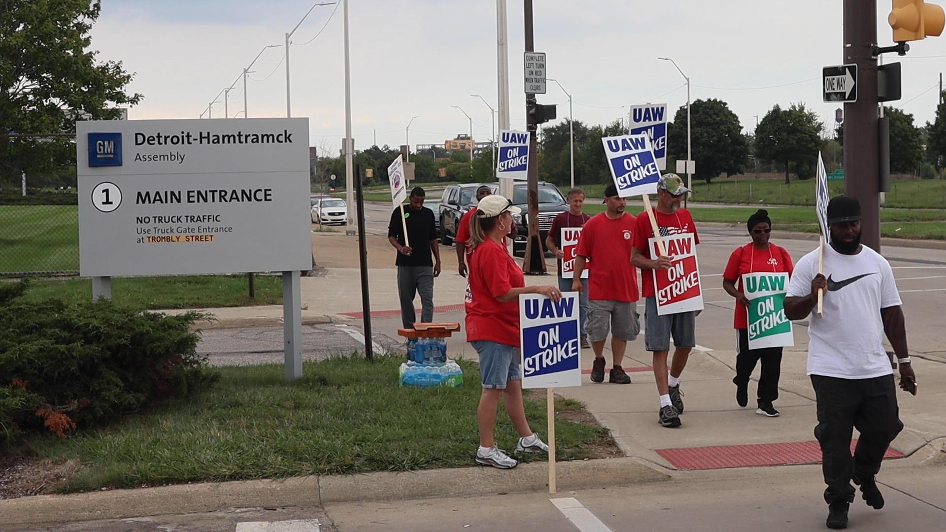 GM switches health insurance costs to union for striking workers as talks continue