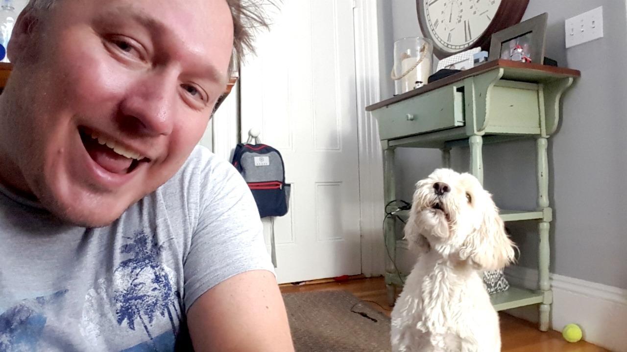 Doug tests out a dog selfie tool
