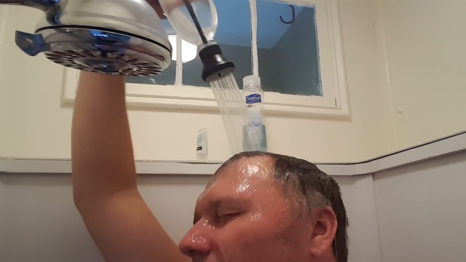 Doug turns a soda bottle into a shower