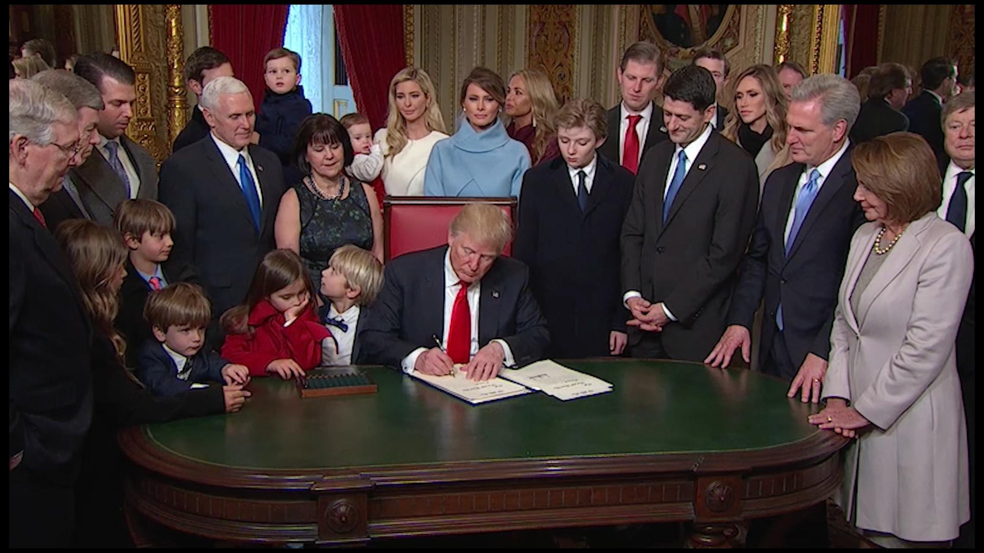 Image result for trump signing his first executive order