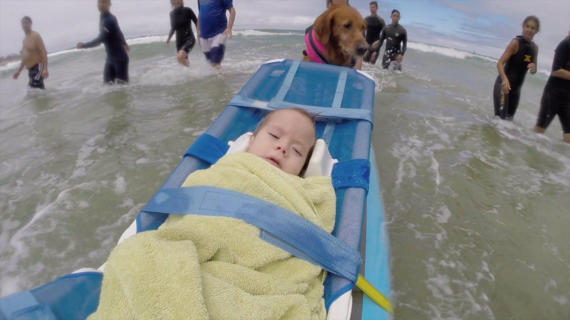 Young sisters with terminal illnesses surf with help of a dog