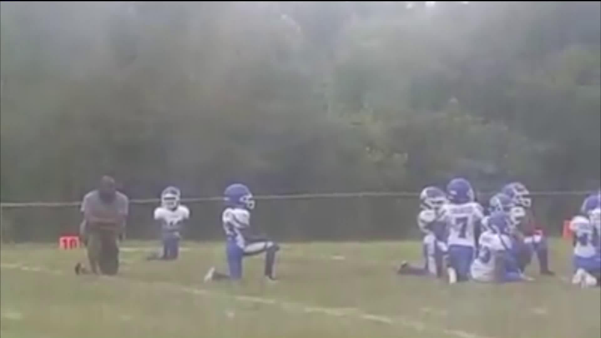 8-year-old football players kneel during national anthem before game