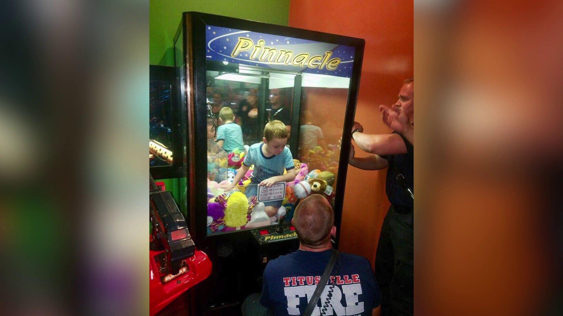 Florida boy trapped inside claw machine rescued by firefighters