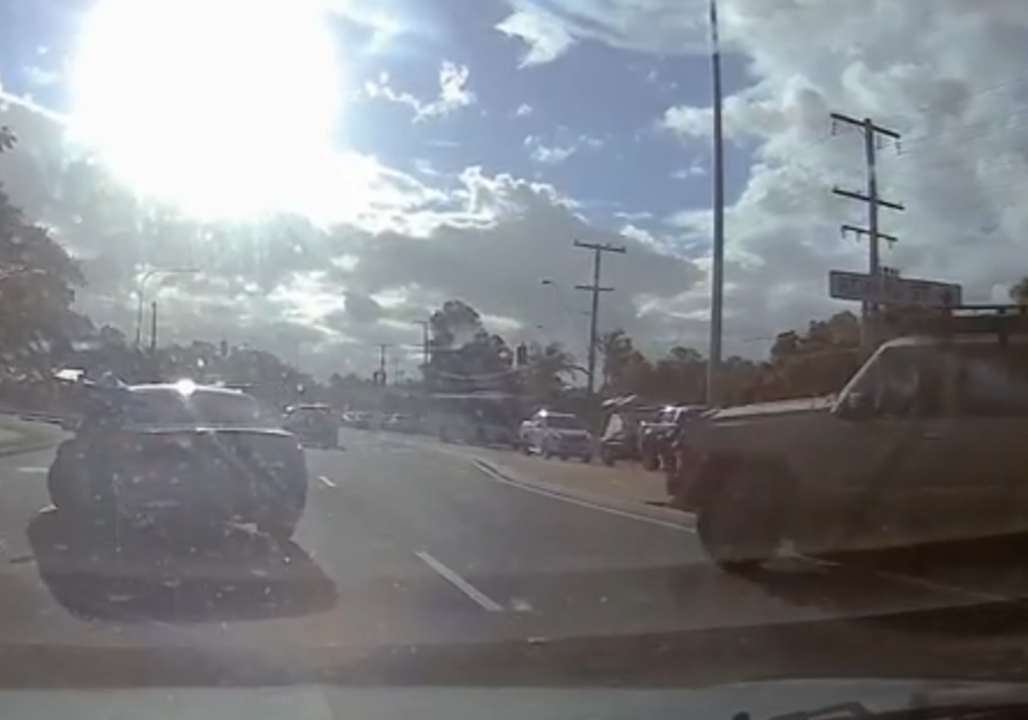 Dashcam footage captures 4x4 reversing into oncoming traffic