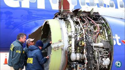 Southwest passenger tried to pull doomed woman in by belt loops