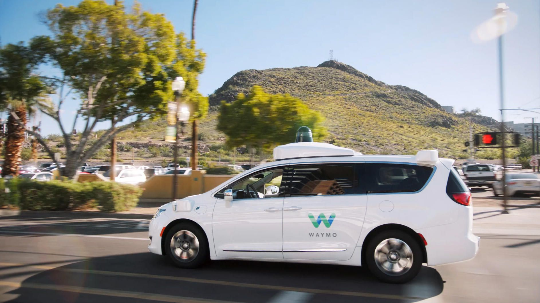 Waymo robotaxis are now carrying paying customers in ...