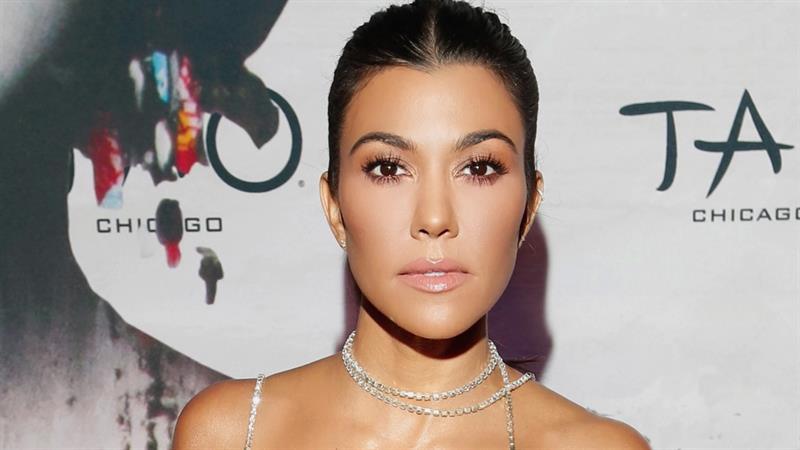 Kourtney Kardashian goes super retro in latest poolside snap