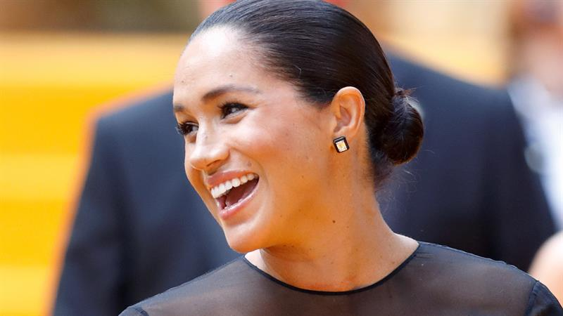 Duchess Meghan overheard telling Pharrell that royal life isn't 'easy' at 'Lion King' premiere