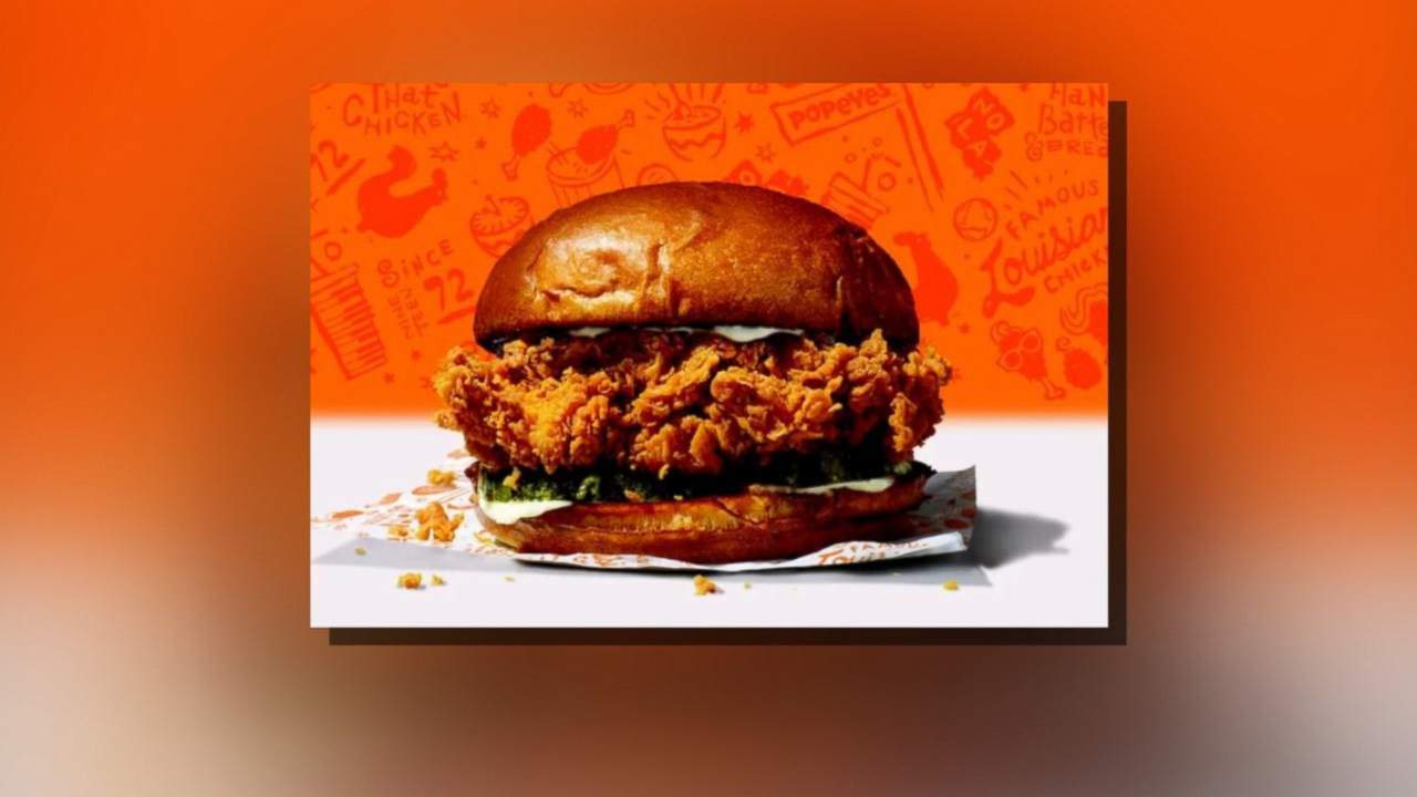 Internet goes wild over viral photo of meeting between Popeyes and Chick-fil-A employee