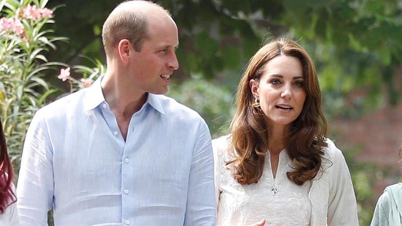 Puppy love! Kate Middleton and Prince William play with puppies in Pakistan
