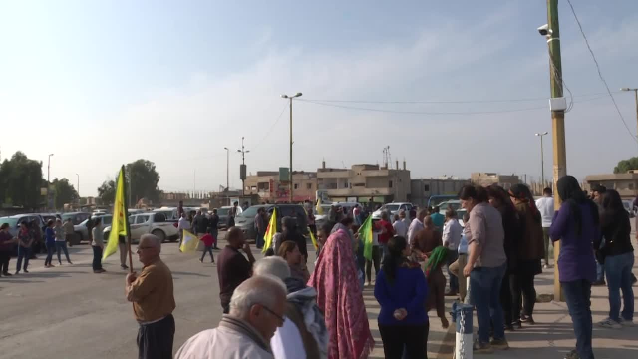 Kurds Confront Exiting U.S. Troops In Syria With Heartbreaking Signs
