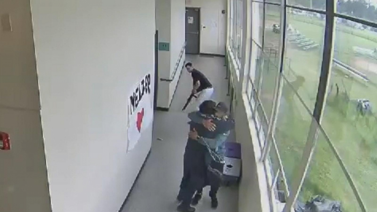 New video shows shocking moment football coach disarms shotgun-wielding student