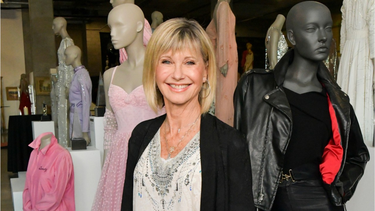 Olivia Newton-John's iconic black leather pants from 'Grease' sell for $162K to Spanx founder