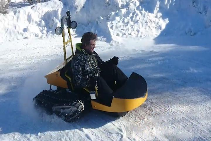 This electric snow sled has a top speed of 28 mph