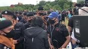 Thai protesters break police barricade to storm sacred royal field