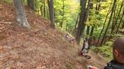 Guy Slides Downhill With Bike After It Flips Over While Riding