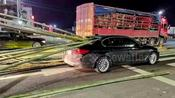 Bamboo sticks impale car through back windscreen after falling off transport truck in China