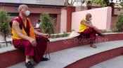 Buddhist monks praying outside pandemic closed Mahabodhi temple in Bodh Gaya, Bihar, India