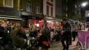Londoners swarm Soho for Friday night revelry following lockdown lift