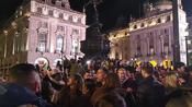 Piccadilly Circus turns into raucous party town after COVID-19 lockdown lifts