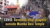 COVID: Devotees offer prayers outside Mumba Devi Temple